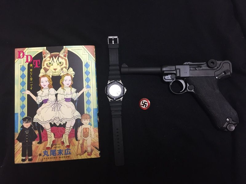 丸尾末広の漫画と腕時計とナチバッチとモーゼルルガーP08